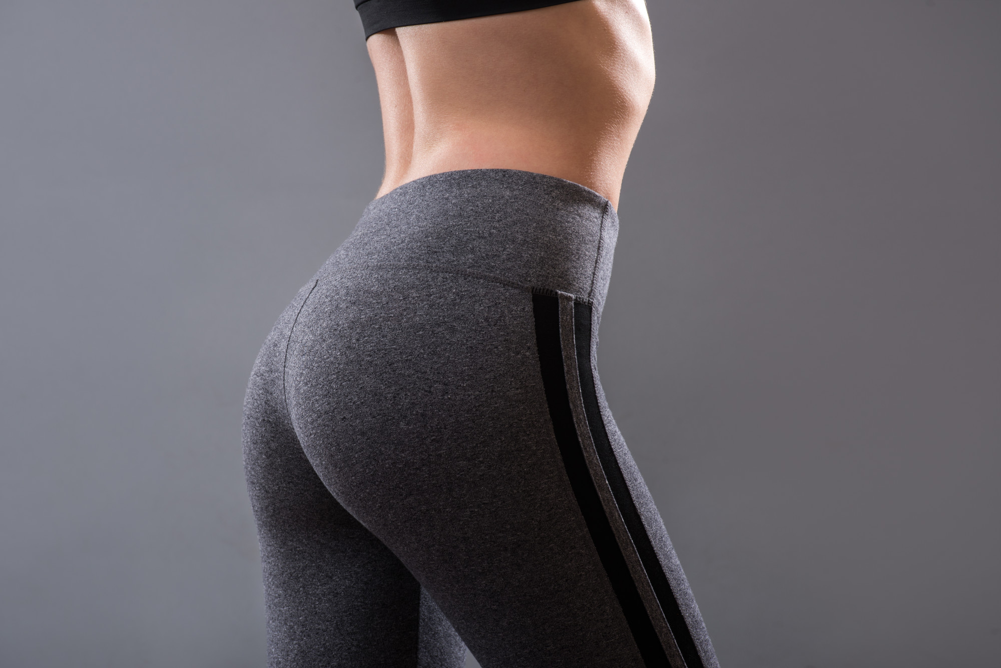 woman's booty in yoga pants