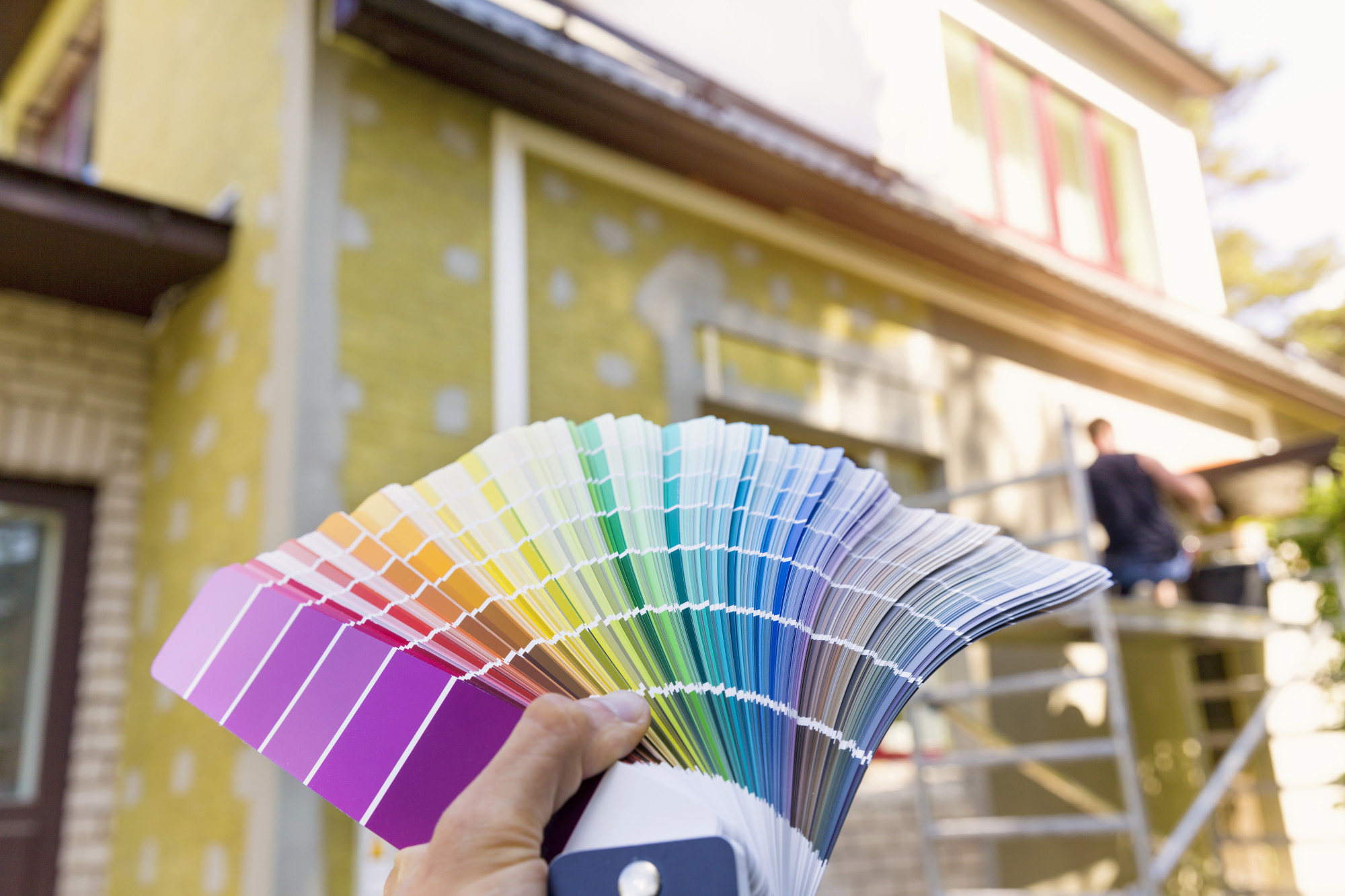 Person Deciding on a Color for a House Exterior